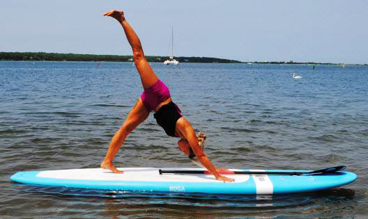 Exercise on paddle boards with Hawaii Ocean Sports